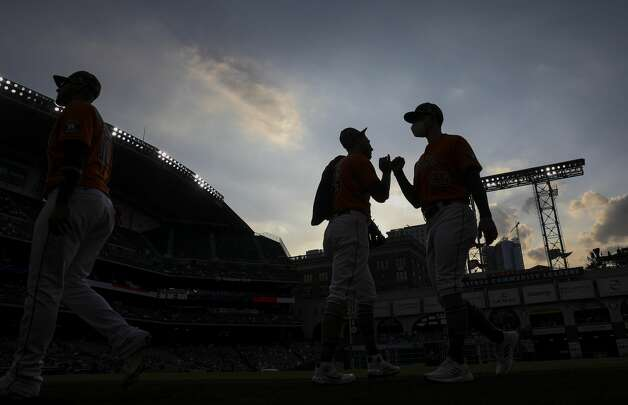 Houston Astros relief pitcher Bryan Abreu (66), center, greets assistant pitching coach Bill Murphy before a game between the Houston Astros and the Texas Rangers on Friday, May 14, 2021, at Minute Maid Park in Houston. Photo: Jon Shapley/Staff Photographer / © 2021 Houston Chronicle