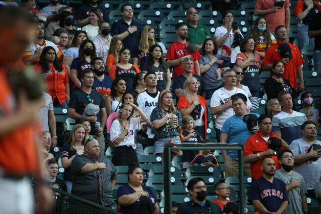 Fans listen to the national anthem before a game between the Houston Astros and the Texas Rangers on Friday, May 14, 2021, at Minute Maid Park in Houston. Photo: Jon Shapley/Staff Photographer / © 2021 Houston Chronicle