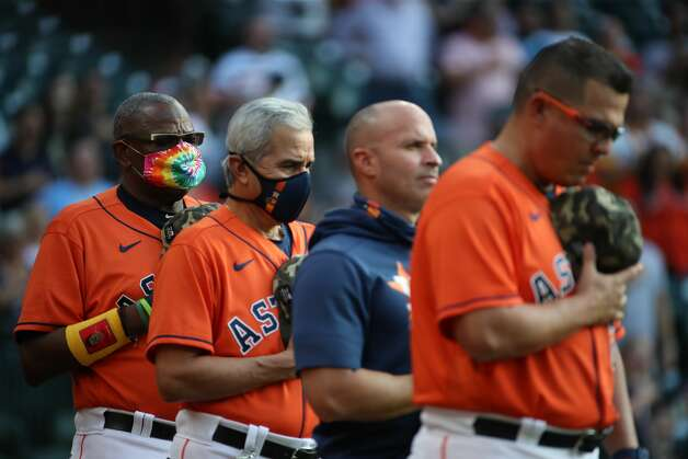 Houston Astros manager Dusty Baker Jr. (12) listens during the national anthem before a game between the Houston Astros and the Texas Rangers on Friday, May 14, 2021, at Minute Maid Park in Houston. Photo: Jon Shapley/Staff Photographer / © 2021 Houston Chronicle
