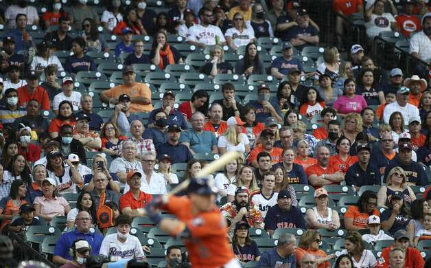 Fans watch as Houston Astros third baseman Alex Bregman (2) bats during the first inning of an MLB game Friday, May 14, 2021, at Minute Maid Park in Houston. Photo: Jon Shapley/Staff Photographer / © 2021 Houston Chronicle