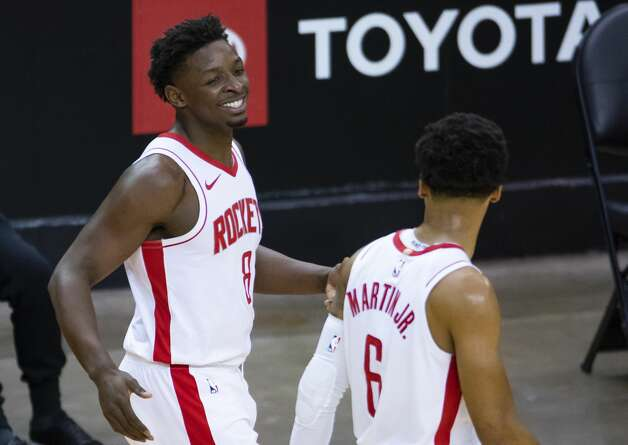 Houston Rockets forward Jae'Sean Tate (8) celebrates after a play with Houston Rockets forward Kenyon Martin Jr. (6) during the third quarter of an NBA game between the Houston Rockets and the LA Clippers on Friday, May 14, 2021, at Toyota Center in Houston. Photo: Mark Mulligan/Staff Photographer / © 2021 Mark Mulligan / Houston Chronicle