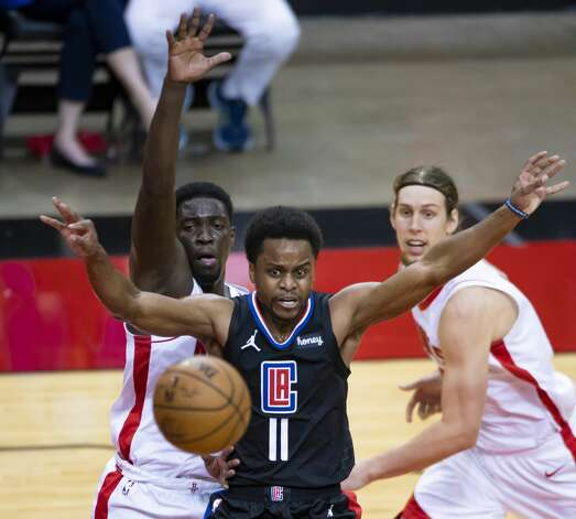 LA Clippers guard Yogi Ferrell (11) passes during the second quarter of an NBA game between the Houston Rockets and the LA Clippers on Friday, May 14, 2021, at Toyota Center in Houston. Photo: Mark Mulligan/Staff Photographer / © 2021 Mark Mulligan / Houston Chronicle