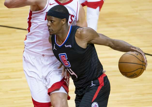LA Clippers guard Rajon Rondo (4) drives past Houston Rockets forward Kelly Olynyk (41) during the second quarter of an NBA game between the Houston Rockets and the LA Clippers on Friday, May 14, 2021, at Toyota Center in Houston. Photo: Mark Mulligan/Staff Photographer / © 2021 Mark Mulligan / Houston Chronicle
