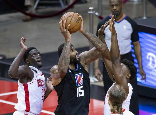 LA Clippers center DeMarcus Cousins (15) shoots over Houston Rockets forward Jae'Sean Tate (8) during the third quarter of an NBA game between the Houston Rockets and the LA Clippers on Friday, May 14, 2021, at Toyota Center in Houston. Photo: Mark Mulligan/Staff Photographer / © 2021 Mark Mulligan / Houston Chronicle