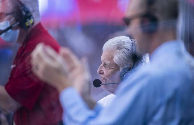 Longtime Houston Rockets play by play broadcaster Bill Worrell watches a video tribute to him played during the second quarter of an NBA game between the Houston Rockets and the LA Clippers on Friday, May 14, 2021, at Toyota Center in Houston. Tonight is Worrell's final game before retiring from play by play duties. Photo: Mark Mulligan/Staff Photographer / © 2021 Mark Mulligan / Houston Chronicle