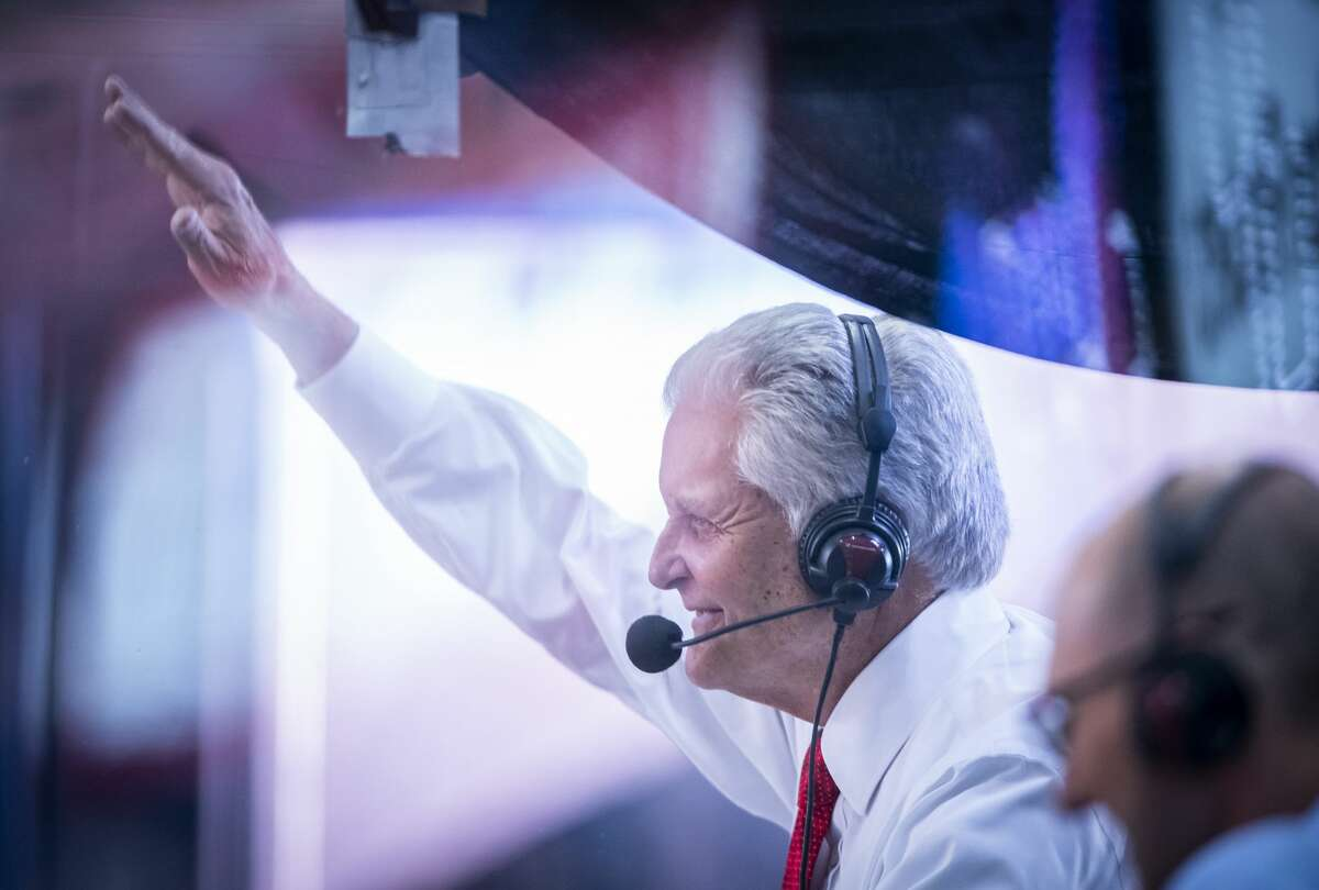 Longtime Rockets broadcaster Bill Worrell waves to the crowd after he watched a video tribute to his career during the second quarter of Friday's win over the Clippers at Toyota Center. The game was Worrell's last as the team's play-by-play announcer.