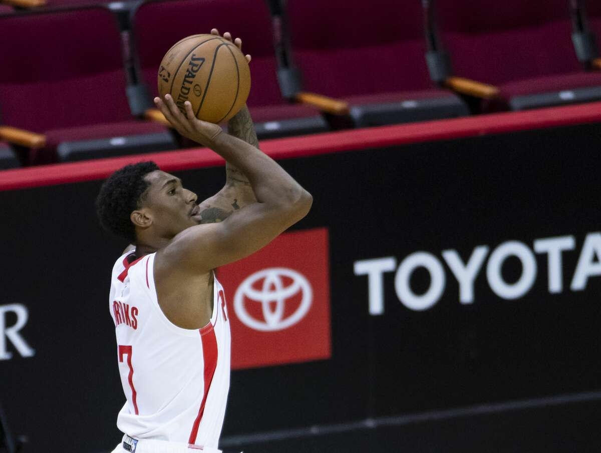Houston Rockets guard Armoni Brooks (7) shoots a 3-pointer during the first quarter of an NBA game between the Houston Rockets and the LA Clippers on Friday, May 14, 2021, at Toyota Center in Houston.