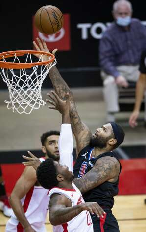 LA Clippers center DeMarcus Cousins (15) shoots during the first quarter of an NBA game between the Houston Rockets and the LA Clippers on Friday, May 14, 2021, at Toyota Center in Houston. Photo: Mark Mulligan/Staff Photographer / © 2021 Mark Mulligan / Houston Chronicle