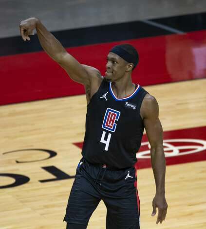 LA Clippers guard Rajon Rondo (4) shoots during the first quarter of an NBA game between the Houston Rockets and the LA Clippers on Friday, May 14, 2021, at Toyota Center in Houston. Photo: Mark Mulligan/Staff Photographer / © 2021 Mark Mulligan / Houston Chronicle