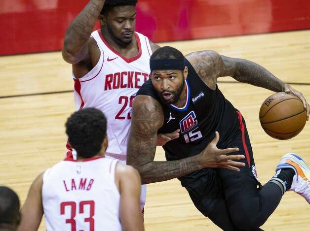 LA Clippers center DeMarcus Cousins (15) drives around Houston Rockets forward Cameron Oliver (25) during the first quarter of an NBA game between the Houston Rockets and the LA Clippers on Friday, May 14, 2021, at Toyota Center in Houston. Photo: Mark Mulligan/Staff Photographer / © 2021 Mark Mulligan / Houston Chronicle