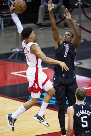 Houston Rockets forward Kenyon Martin Jr. (6) is fouled by LA Clippers center Serge Ibaka (9) on a dunk attempt during the second quarter of an NBA game between the Houston Rockets and the LA Clippers on Friday, May 14, 2021, at Toyota Center in Houston. Photo: Mark Mulligan/Staff Photographer / © 2021 Mark Mulligan / Houston Chronicle