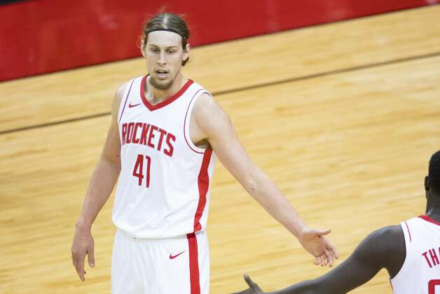 Houston Rockets forward Kelly Olynyk (41) high-fives a teammate after a basket during the first quarter of an NBA game between the Houston Rockets and the LA Clippers on Friday, May 14, 2021, at Toyota Center in Houston. Photo: Mark Mulligan/Staff Photographer / © 2021 Mark Mulligan / Houston Chronicle