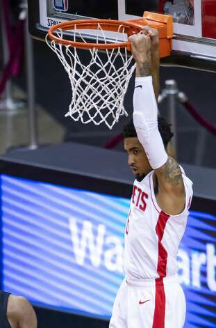 Houston Rockets forward Kenyon Martin Jr. (6) hangs on the basket after a dunk during the first quarter of an NBA game between the Houston Rockets and the LA Clippers on Friday, May 14, 2021, at Toyota Center in Houston. Photo: Mark Mulligan/Staff Photographer / © 2021 Mark Mulligan / Houston Chronicle