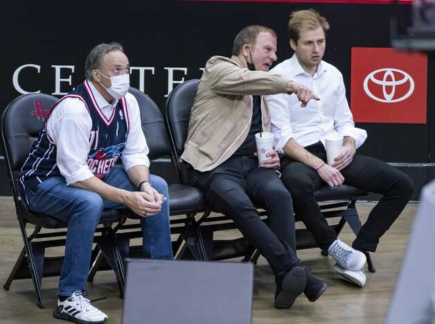 Rockets CEO Tad Brown, Rockets owner Tilman Fertitta and Patrick Fertitta watch during the fourth quarter of an NBA game between the Houston Rockets and the LA Clippers on Friday, May 14, 2021, at Toyota Center in Houston. Photo: Mark Mulligan/Staff Photographer / © 2021 Mark Mulligan / Houston Chronicle