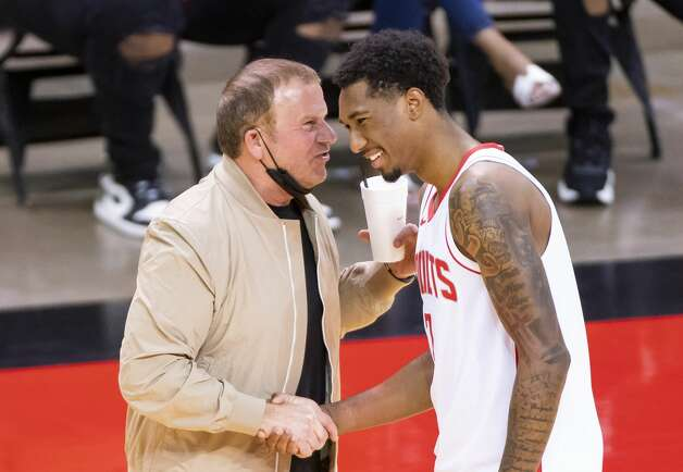 Houston Rockets owner Tilman Fertitta talks with Houston Rockets guard Armoni Brooks (7) after the fourth quarter of an NBA game between the Houston Rockets and the LA Clippers on Friday, May 14, 2021, at Toyota Center in Houston. Brooks played college basketball at the University of Houston. Photo: Mark Mulligan/Staff Photographer / © 2021 Mark Mulligan / Houston Chronicle