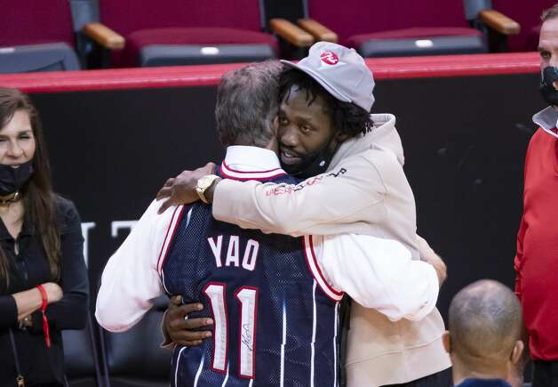 Former Houston Rocket and current LA Clipper Patrick Beverley hugs Rockets CEO Tad Brown after the fourth quarter of an NBA game between the Houston Rockets and the LA Clippers on Friday, May 14, 2021, at Toyota Center in Houston. Photo: Mark Mulligan/Staff Photographer / © 2021 Mark Mulligan / Houston Chronicle