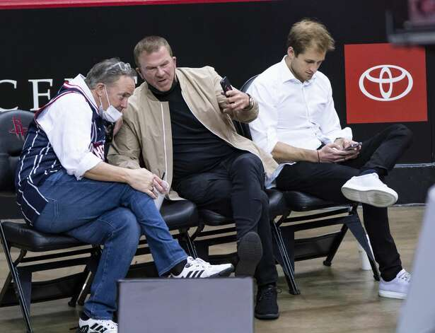 Rockets CEO Tad Brown talks with Rockets owner Tilman Fertitta during the fourth quarter of an NBA game between the Houston Rockets and the LA Clippers on Friday, May 14, 2021, at Toyota Center in Houston. Photo: Mark Mulligan/Staff Photographer / © 2021 Mark Mulligan / Houston Chronicle