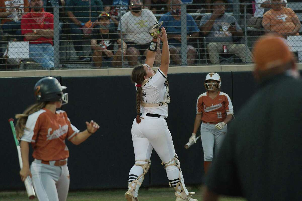 Clear Springs' Kelly Baker, catching a pop-up against Pasadena Dobie, delivered the game-winning hit in the bottom of the seventh inning Thursday to lift the Lady Chargers past Katy, 2-1.