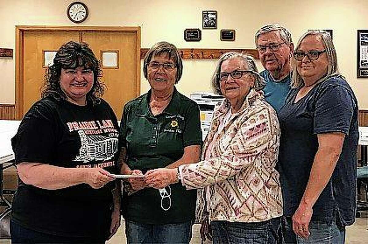 Prairie Land Heritage Museum Institute President Lori Hanson (from left) accepts a $1,000 check from Morgan County Garden Club members Anita Moody, Diane Webster, Don Pigg and Karen Waltrip-Sexton. The money represents some of the proceeds from the club's spring plant sales. The garden club helps to maintain the landscaping around Prairie Land's church and school and holds its meetings there.