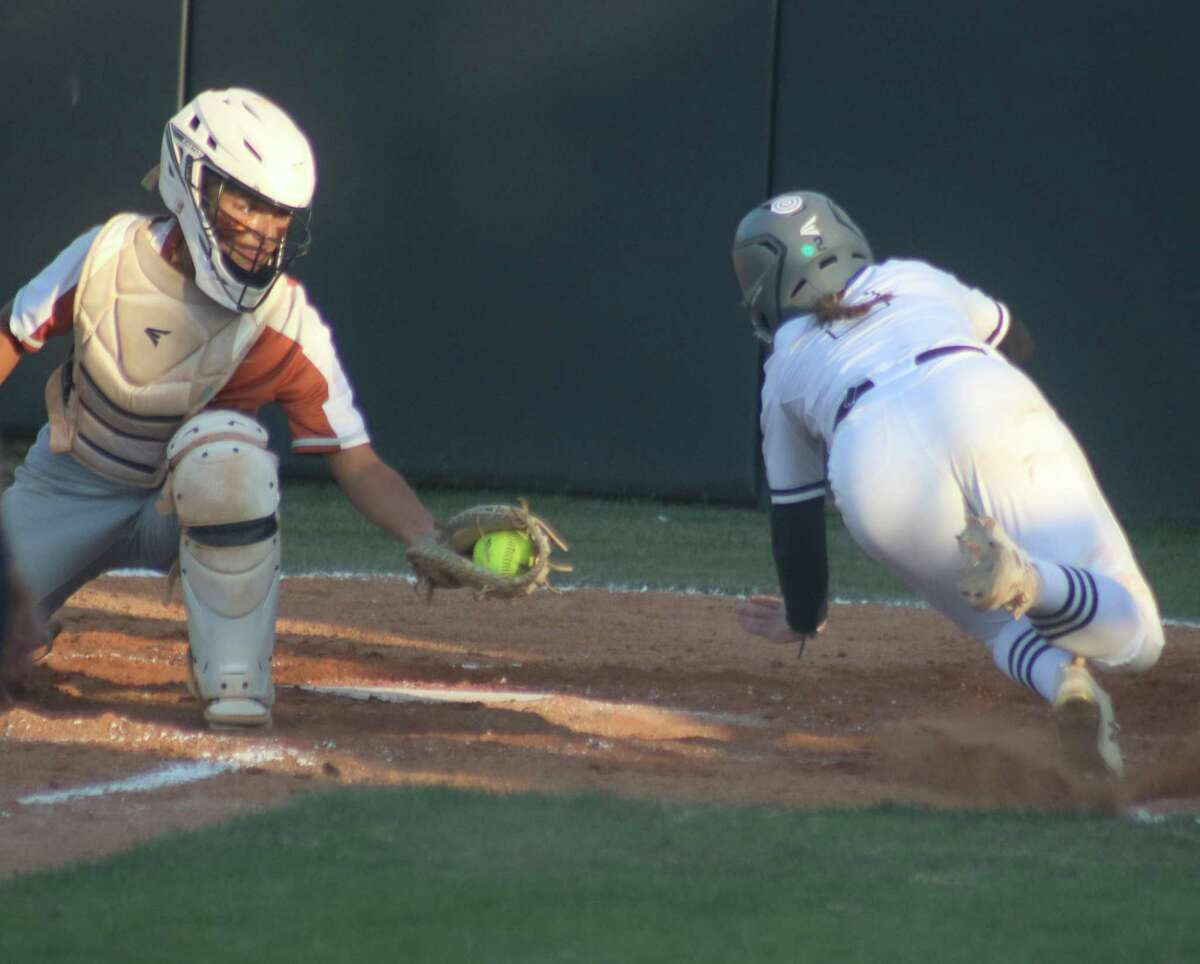 Dobie catcher Bella Perez has the softball waiting for Clear Springs runner Demi Elder as she was attempting to score in the third inning on an infield grounder. But Springs argued she was safe.