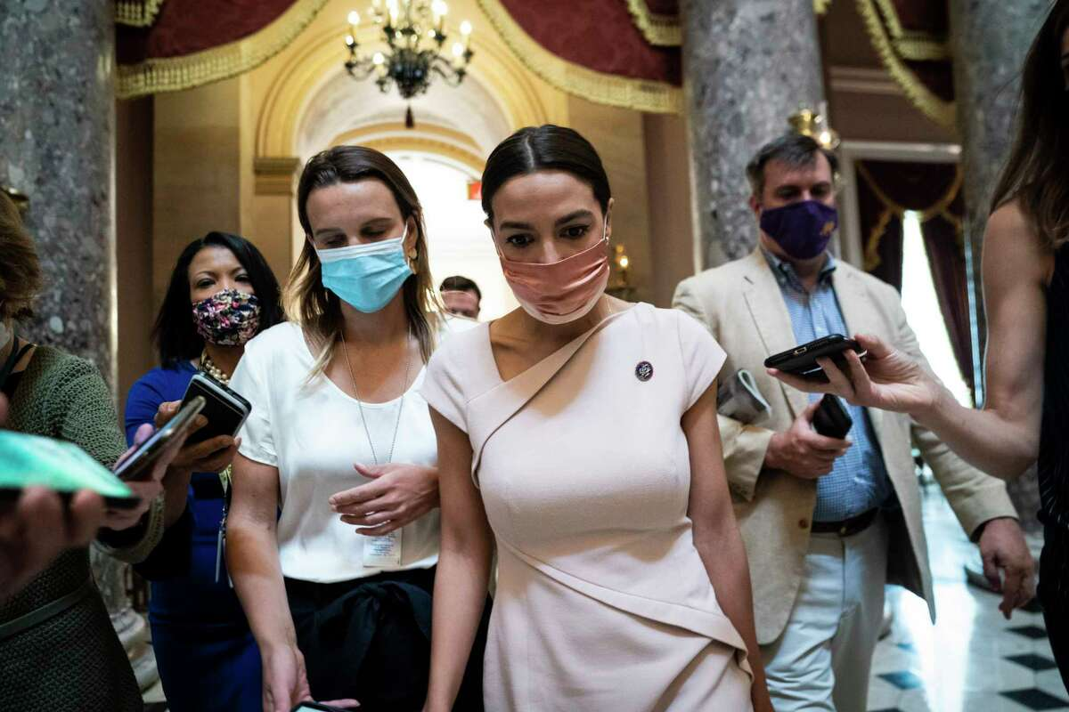 Rep. Alexandria Ocasio-Cortez, D-N.Y., walks out after a vote on Capitol Hill on Thursday.