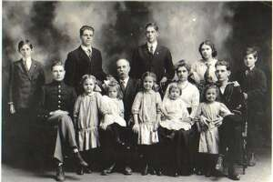 A photo of Hine's garndfather, W. Theodore Hine is on the far left, and his family. This photo was taken around 1913.