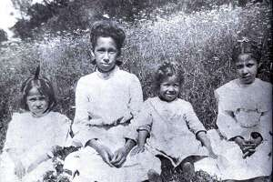 "Flashback The Heacock sisters Courtesy of ""Images of America - New Milford"" SPECTRUM/This photograph from 1901 shows four sisters, from left to right, Cora, Alvira, Ethel and Mildred Heacock, the daughters of Alfred and Elizabeth Benson Heacock of New Milford, sitting in a field of wildflowers at the Sherman home of their maternal grandfather, Minot Benson. The Heacock family was well known in the Greater New Milford area for much of the 20th century. Those who would like to loan or contribute a photo from any of the Greater New Milford-area towns should bring it to Norm Cummings at the Greater New Milford Spectrum office at 45B Main St. If the photo is to be returned, please leave a phone number and mailing address."