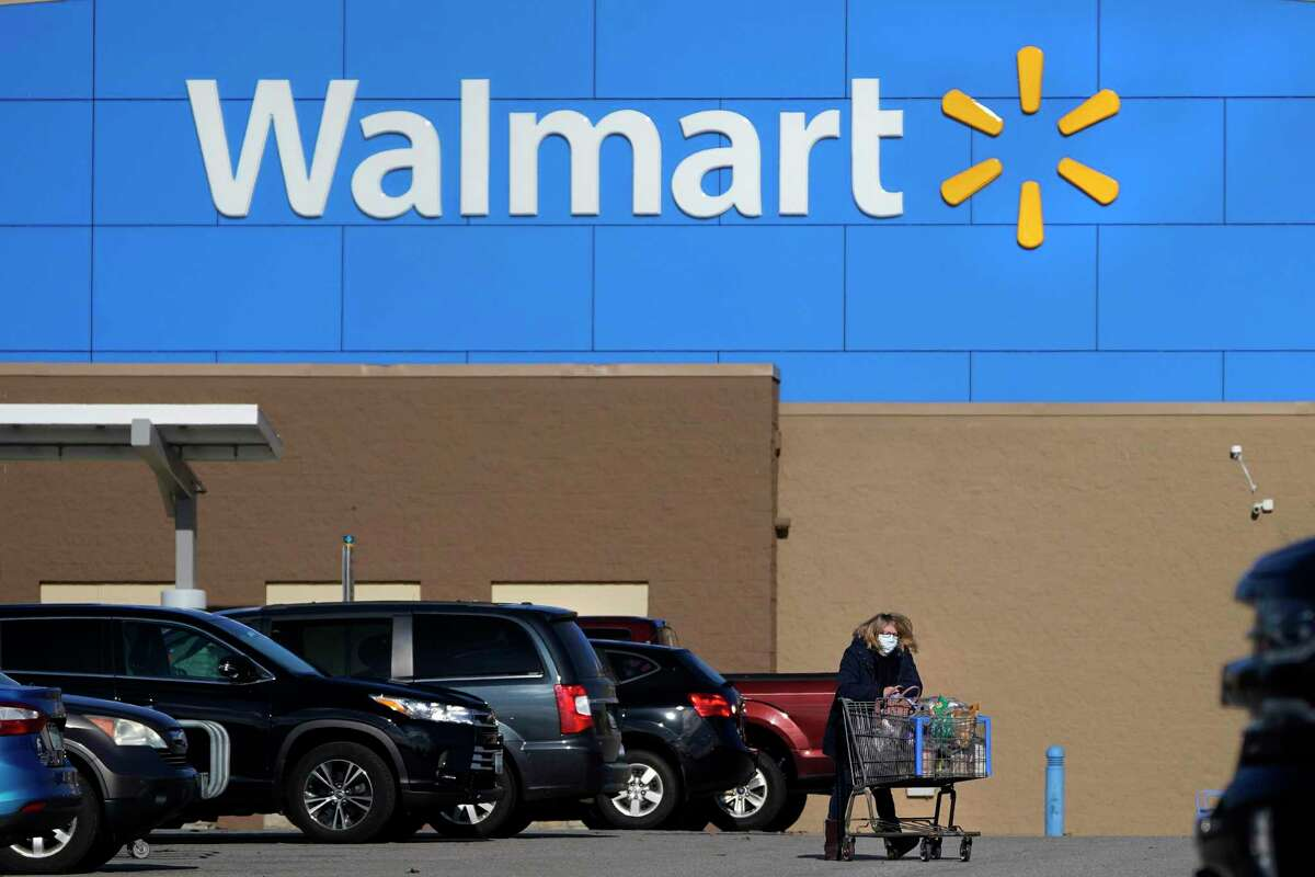 Walmart, the world's largest retailer, said Friday, that it won't require vaccinated shoppers or workers to wear a mask in its U.S. stores.
