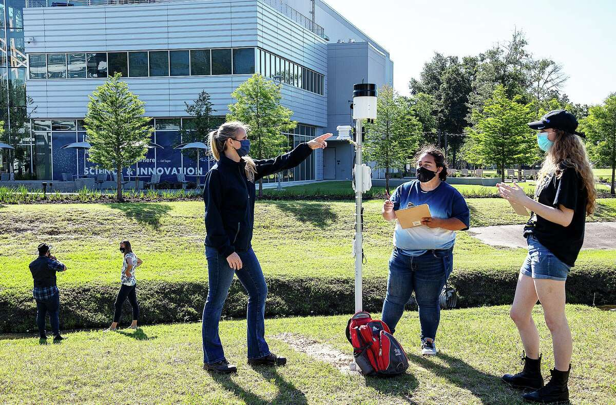 Lone Star College-University Park geology professor, Dr. Christa Spears (left), shows students how to record measurements using the college's new weather station and stream gauge, which will be incorporated into the college's Meteorology class this fall semester.