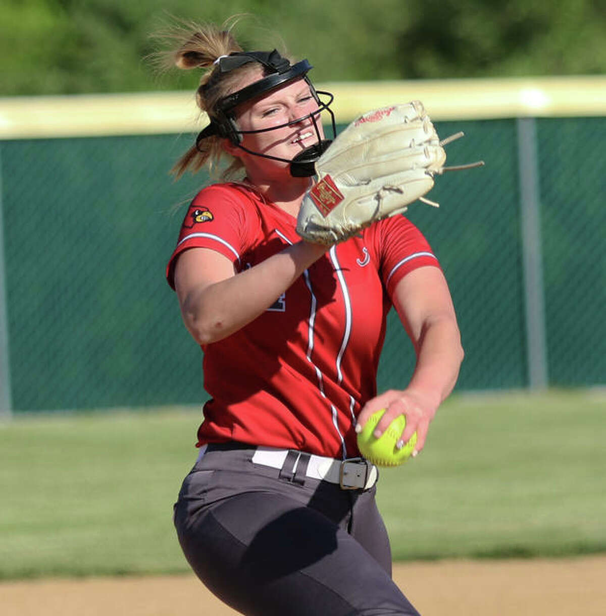 Alton's Alyson Haegele delivers a pitch Friday in her complete-game win over Belleville West in Godfrey.