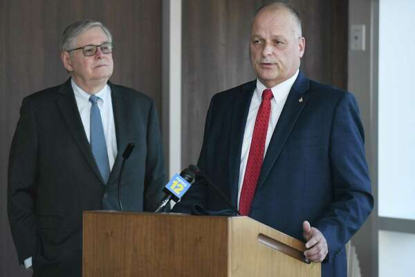 Stamford Director of Public Safety Ted Jankowski, right, speaks beside Mayor David Martin at the Stamford Police Department in Stamford, Conn. Wednesday, May 12, 2021.
