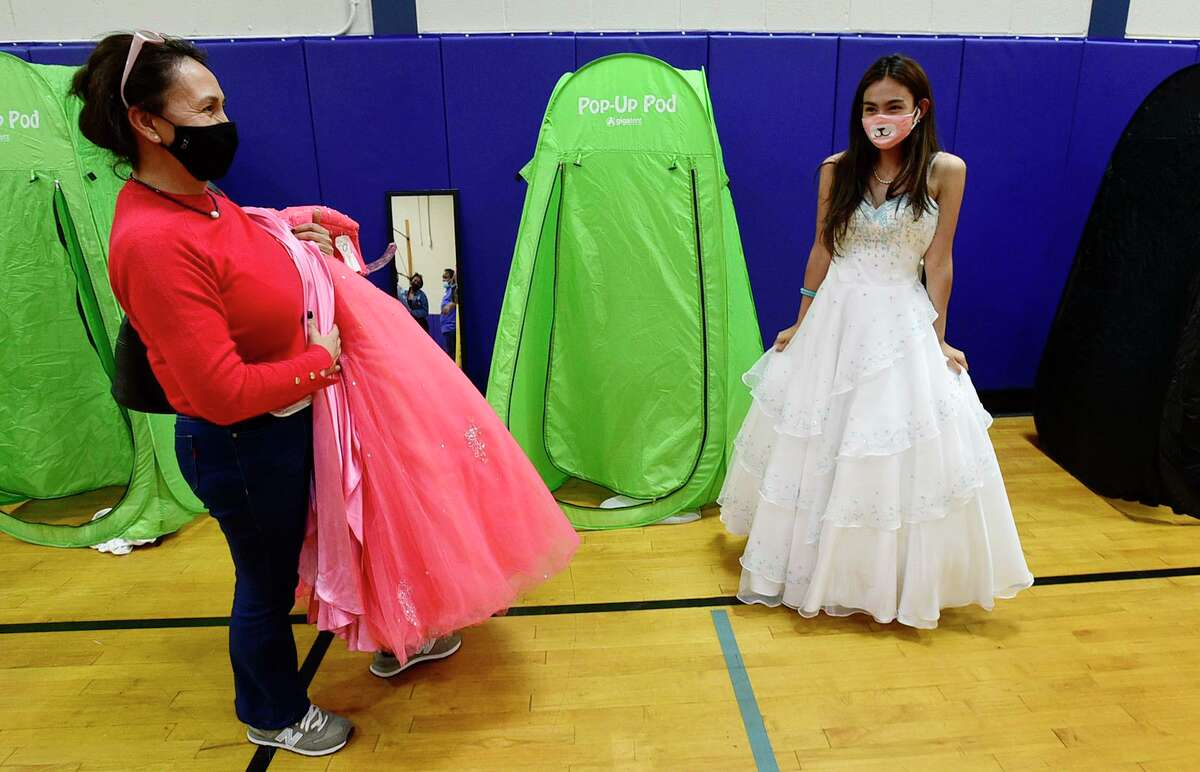 Camila Chavez, a senior at Stamford High School, shops for a dress with her mom, Maria Chavez, during The Cinderella Project prom dress giveaway event Friday, May 14, 2021, at the Boys and Girls Club in Stamford. In years prior, the organization would charge about $20 for a dress, but this year, the dresses are free of charge including shoes, jewelry and makeup.