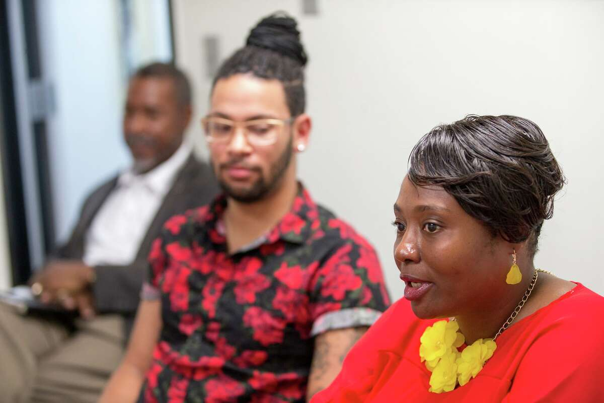 Lou Miller, chief of staff, and Jalen McKee-Rodriguez, then-communications director, listen to District 2 Councilwoman Jada Andrews-Sullivan speak to the editorial board, Monday, Aug. 1 2019, at a conference meeting held at the San Antonio-Express News in San Antonio. Rebecca Slezak/Staff photographer
