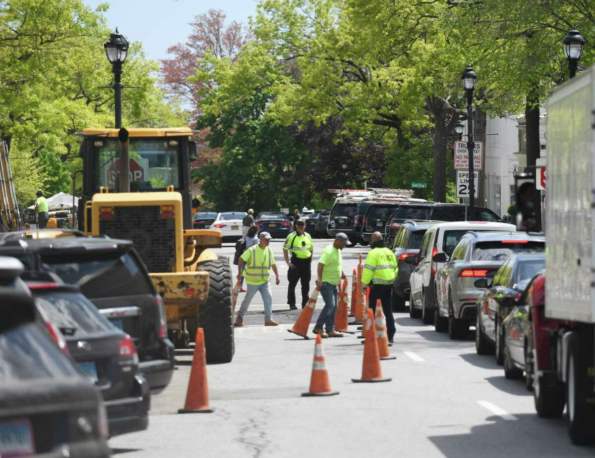 Construction continues at the intersection of Greenwich Avenue and Elm Street in downtown Greenwich on Thursday. Plans to add pedestrian improvements, tree plantings and other safety enhancements at a prominent location on Greenwich Avenue are moving ahead on schedule.