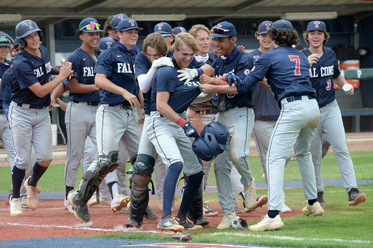 The Falcons celebrate a walk-off home run by Graiden West (17) of Tompkins, resulting in a 12-2 victory over the Elkins Knights in a 6A Region III bi-district baseball playoff game between the Tompkins Falcons and the Elkins Knights on Saturday, May 8, 2021 at Tompkins HS, Katy, TX.