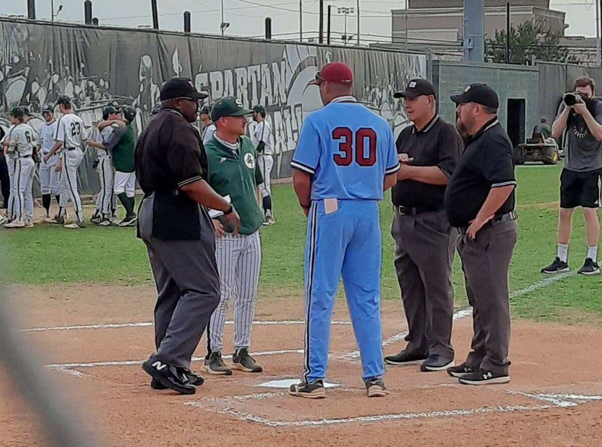 Stratford coach Keith Humphreys and Tompkins coach Kyle Humphreys exchange lineup cards prior to the start of game three of their area playoff series May 14 at Stratford High School.