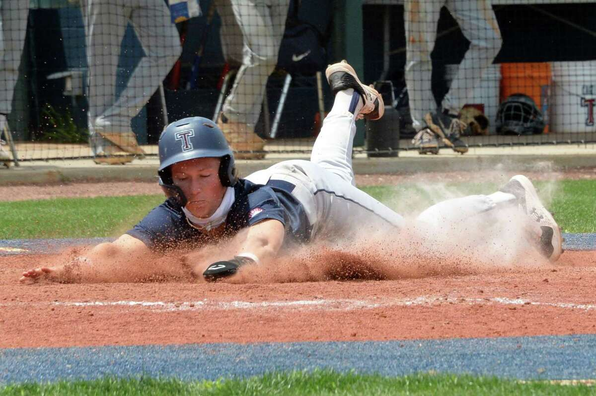 Will Stark (4) of Tompkins slides into home during the fifth inning of a 6A Region III bi-district baseball playoff game between the Tompkins Falcons and the Elkins Knights on Saturday, May 8, 2021 at Tompkins HS, Katy, TX.