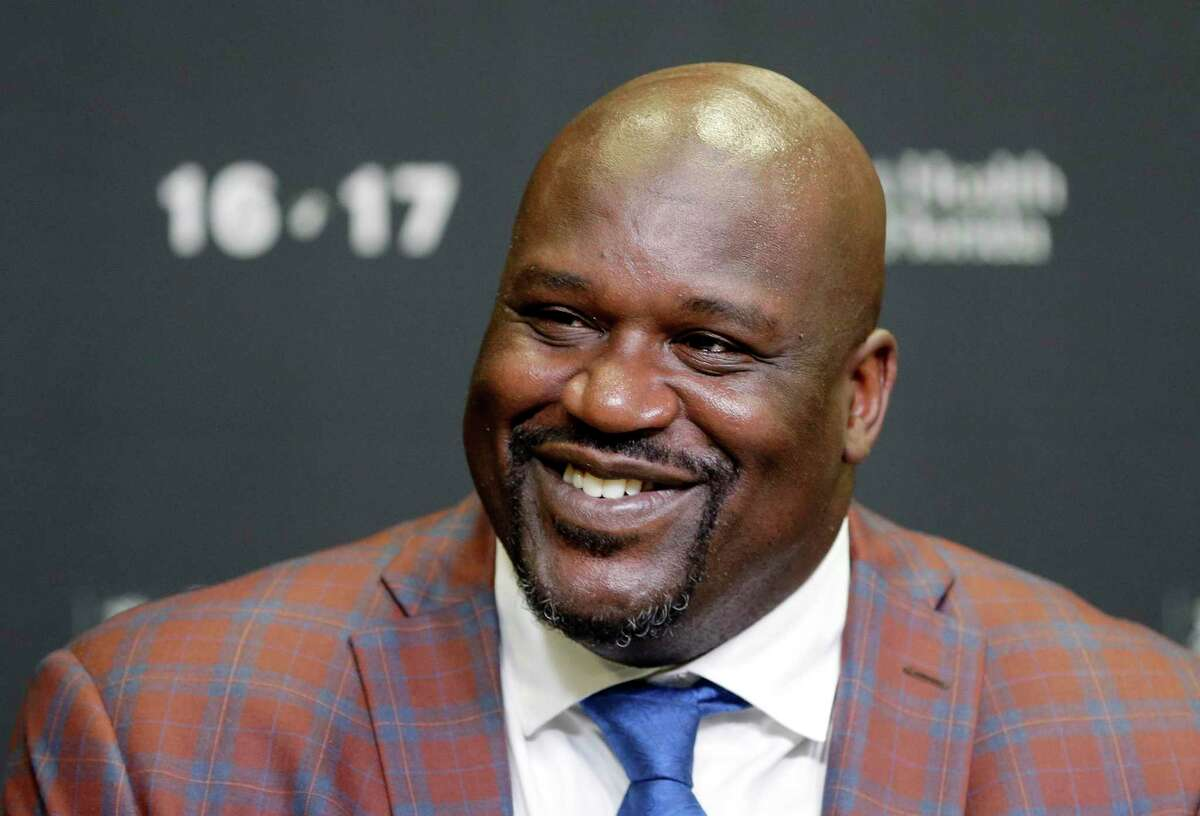 FILE - In this Dec. 22, 2016, file photo, retired Hall of Fame basketball player Shaquille O'Neal smiles as he talks to reporters during an NBA basketball news conference in Miami. O'Neal stars in the basketball comedy,