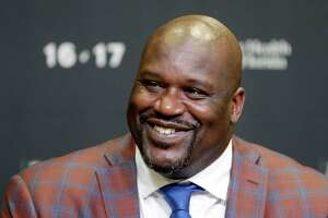 """FILE - In this Dec. 22, 2016, file photo, retired Hall of Fame basketball player Shaquille O'Neal smiles as he talks to reporters during an NBA basketball news conference in Miami. O'Neal stars in the basketball comedy, """"Uncle Drew."""" (AP Photo/Alan Diaz, File)"""