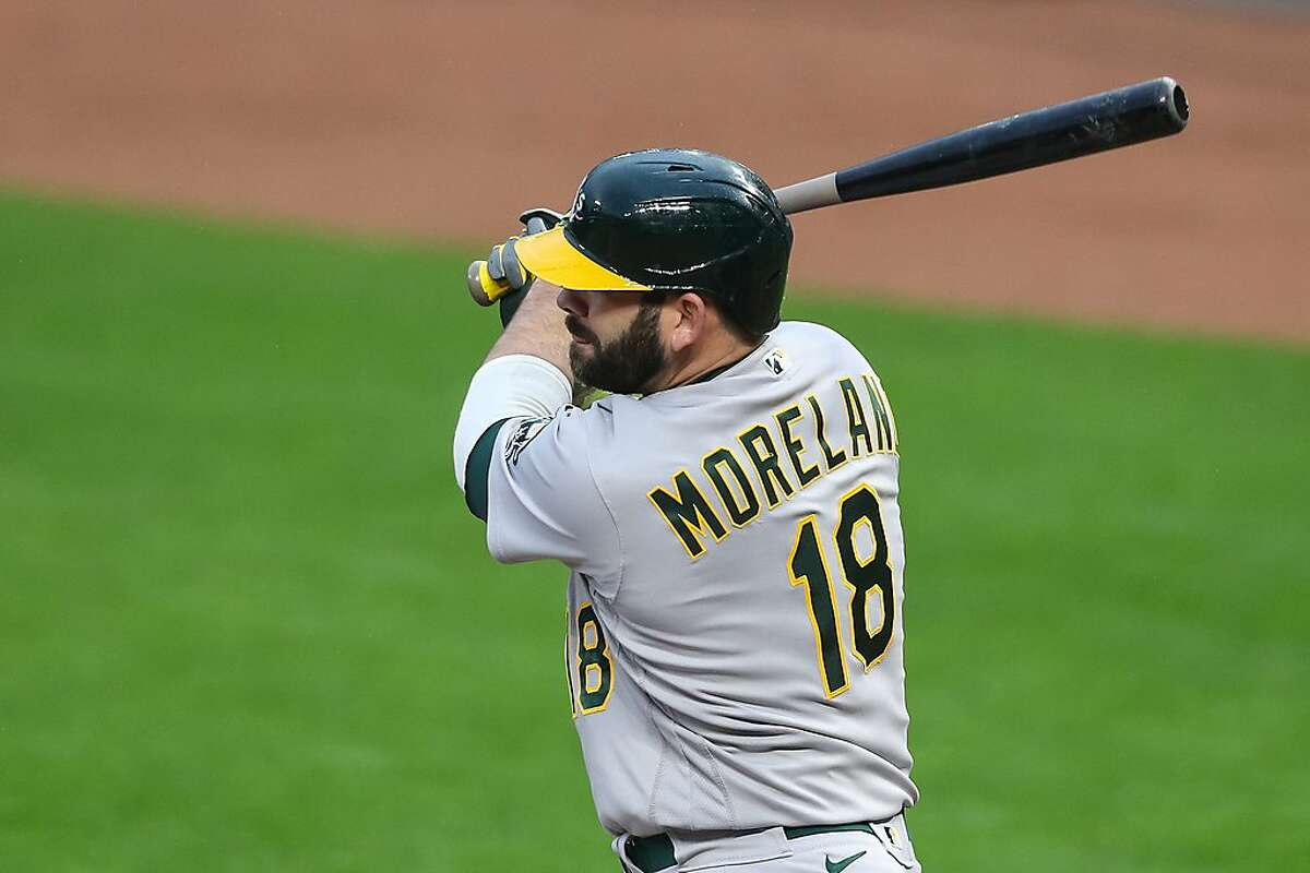 MINNEAPOLIS, MN - MAY 14: Mitch Moreland #18 of the Oakland Athletics hits a double against the Minnesota Twins in the first inning of the game at Target Field on May 14, 2021 in Minneapolis, Minnesota. (Photo by David Berding/Getty Images)