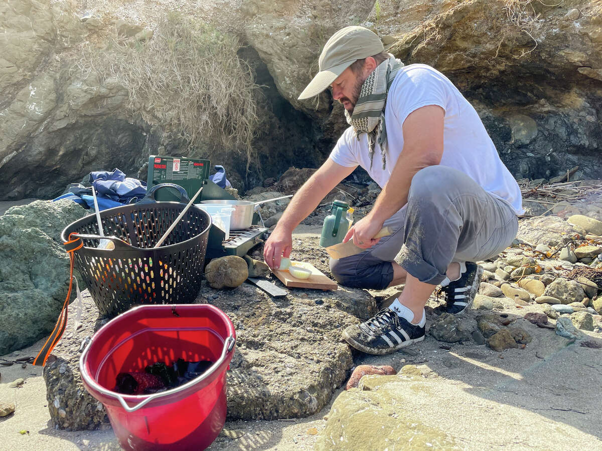 Chopping onion for seaweed ramen on a Central Coast beach.