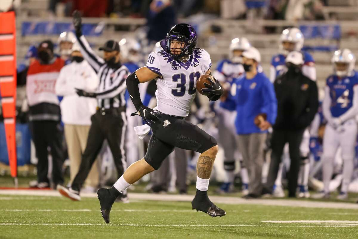 LAWRENCE, KS - NOVEMBER 28: TCU Horned Frogs linebacker Garret Wallow (30) returns a fumble in the third quarter of a Big 12 game between the TCU Horned Frogs and Kansas Jayhawks on November 28, 2020 at Memorial Stadium in Lawrence, KS. The ball was ruled down and nullified the fumble. (Photo by Scott Winters/Icon Sportswire via Getty Images)