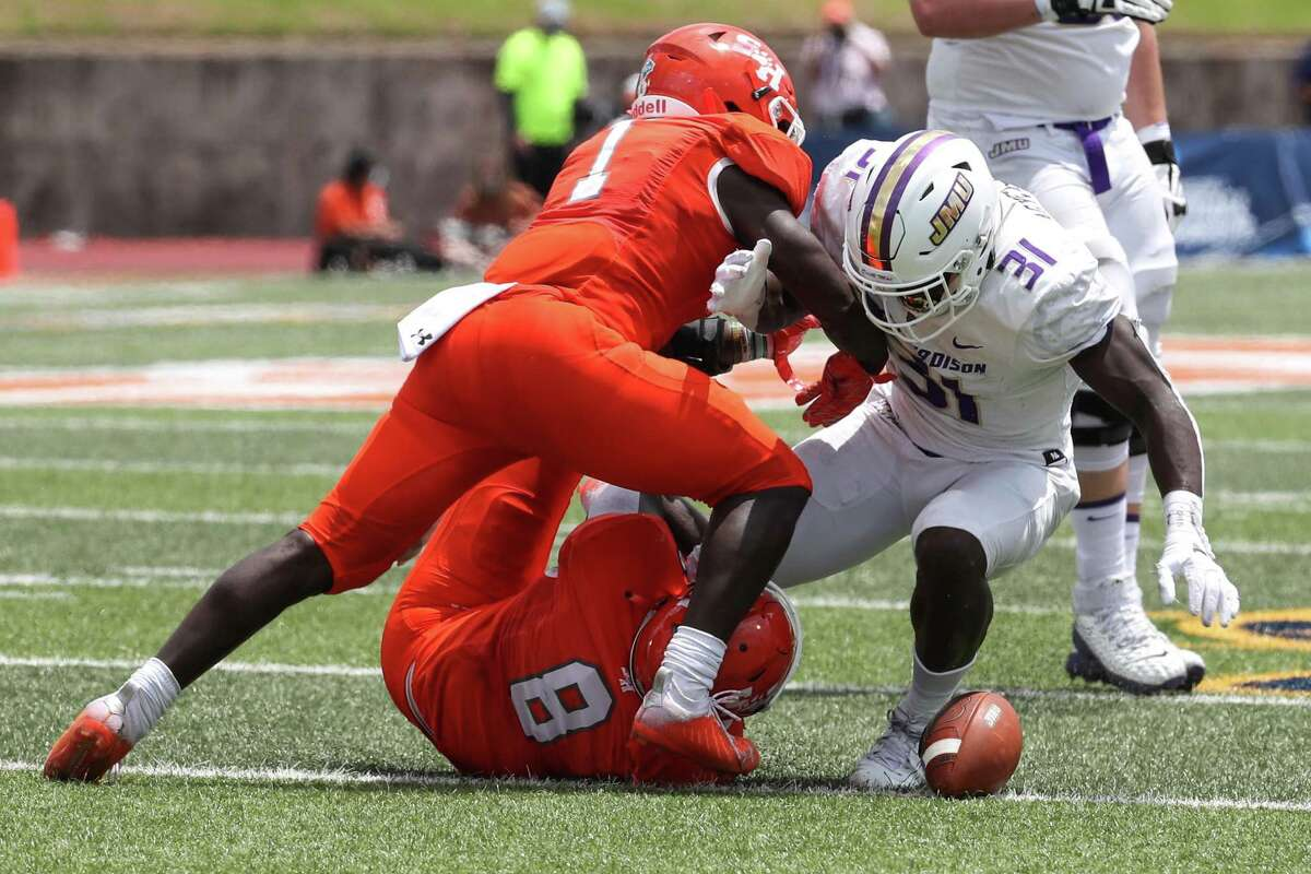 Sam Houston's Quentin Brown (8), helping make a tackle against James Madison last weekend, has round his calling at linebacker, a new position, after moving on from Boise State and leaving Tulane.