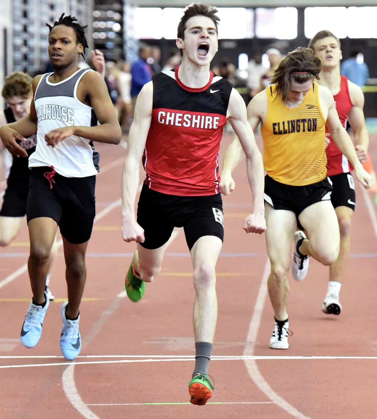New Haven Connecticut - February 22, 2020: Ryan Farrell of Cheshire H.S., wins the the 600-meter run, center, as Talib McBride of Hillhouse H.S. places second, left, and Jack Olender of Ellington H.S. places third during the CIAC State Open Indoor Track Championship Saturday at the Floyd Little Athletic Center in New Haven.