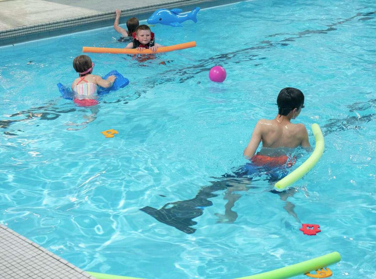 Community members bring their children to an open swim event, COM Community Day 05/15/2021 at COM Aquatics. Tim Fischer/Reporter-Telegram
