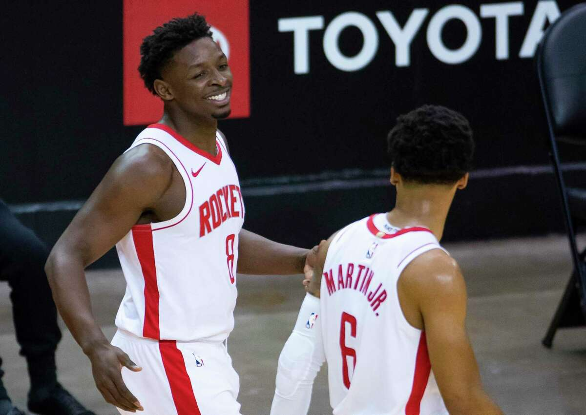 Houston Rockets forward Jae'Sean Tate (8) celebrates with forward Kenyon Martin Jr. (6) after a play during the third quarter of an NBA game against the Los Angeles Clippers on Friday, May 14, 2021, in Houston. (Mark Mulligan/Houston Chronicle via AP)