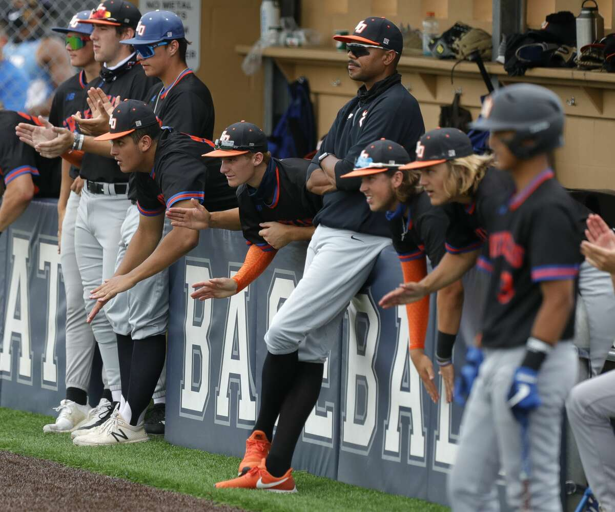 Grand Oaks players cheer in the fifth inning of a Region II-6A area high school playoff game at Tomball Memorial High School, Saturday, May 15, 2021, in Tomball.