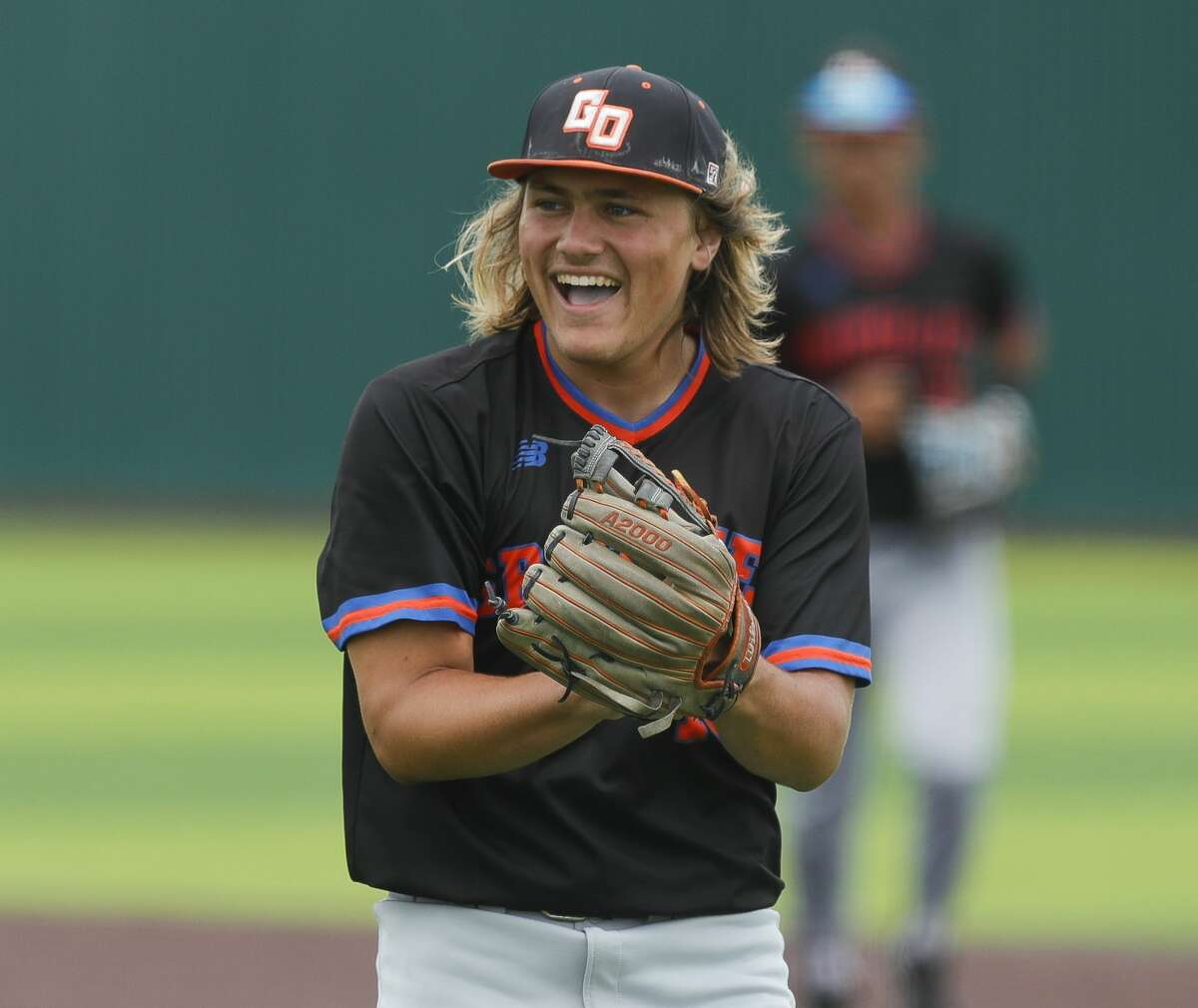 Grand Oaks starting pitcher Hudson Hamilton (19) reacts after a play by catcher Preston Havenor to end the fifth inning of a Region II-6A area high school playoff game at Tomball Memorial High School, Saturday, May 15, 2021, in Tomball.