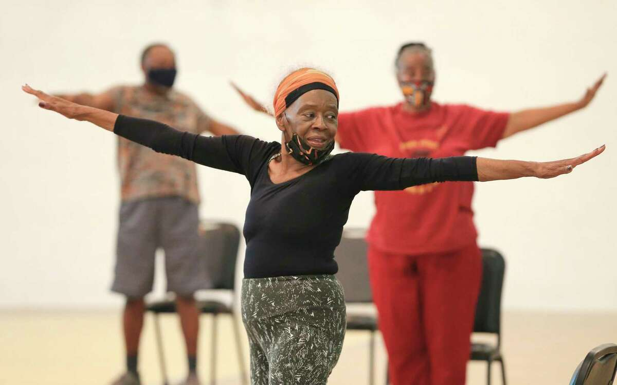 Gloria Lampley-Simmons, 85, leads East Side residents through chair yoga sessions on Monday, May 10, 2021. Lampley-Simmons has been volunteering her time to help others stay fit since 2004. The sessions take place at the Ella Austin Community Center, where Simmons sets up chairs in a circular, social distancing arrangement at the center's gym. The retired nurse also hosts yoga classes on Wednesday and Saturday mornings.