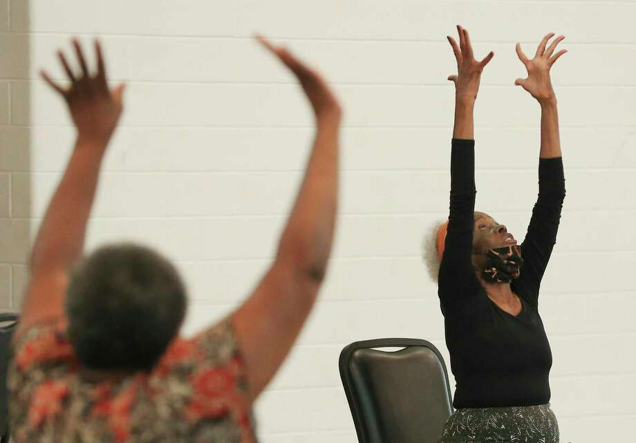 Gloria Lampley- Simmons, 85, leads a chair yoga session at the Ella Austin Community Center. For years, the retired nurse has volunteered her time to help others stay fit, teaching aerobics, chair exercise, line dance and water aerobics. Photo: Kin Man Hui /Staff Photographer / **MANDATORY CREDIT FOR PHOTOGRAPHER AND SAN ANTONIO EXPRESS-NEWS/NO SALES/MAGS OUT/ TV OUT